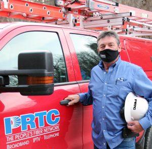 Raymon Rose next to red PRTC pickup holding hard hat